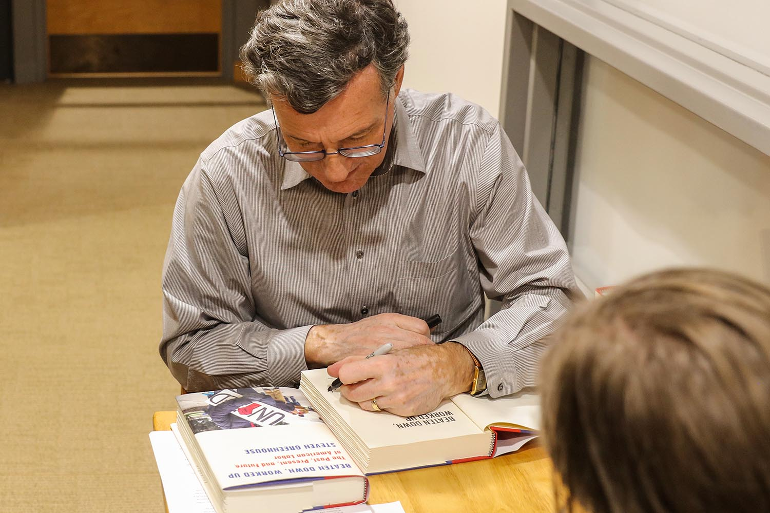 Steven Greenhouse signs copies of his book.
