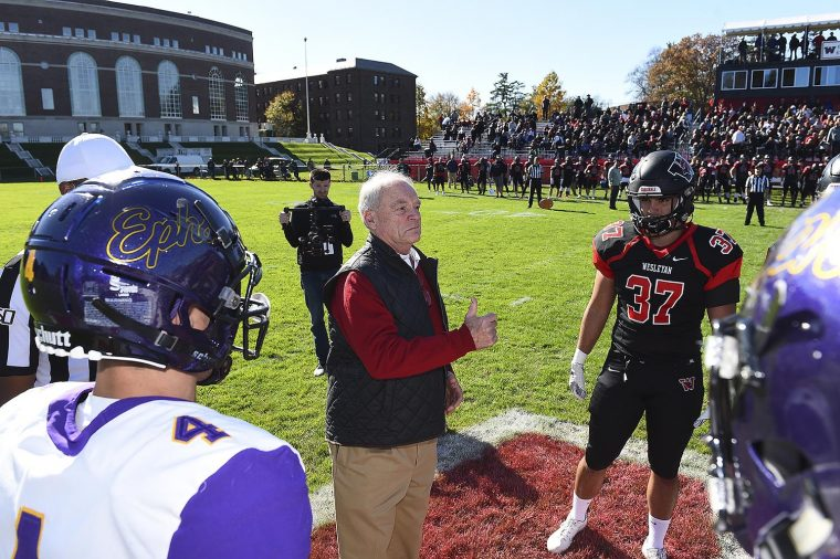 Williams and Wesleyan face off for the coin toss, with alumnus Jeff Diamond '70 at center, doing the toss.