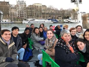 Wesleyan and Vassar students studying in the Vassar-Wesleyan Program in Paris are pictured last year on a bateau-mouche. In the foreground, fifth from the right, is Associate Professor of French Catherine Poisson .