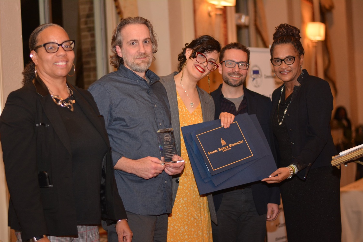 From left, Cheryl Sharp '90, deputy director of the Connecticut Commission on Human Rights and Opportunities (CHRO); Jason Torello, Center for Prison Education alumnus; Allie Cislo, CPE program manager; Daniel McGloin, CPE academic development and planning manager; and Tanya Hughes, CHRO executive director at the 2019 Leaders and Legends award ceremony on Nov. 21.