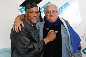 Clyde Meikle shares a hug with Giulio Gallarotti, professor of government, co-chair of the College of Social Studies, following Meikle's graduation Aug. 1 at the Cheshire Correctional Institution. Gallarotti is one of several Wesleyan faculty who teach classes through Wesleyan's Center for Prison Education. (Photos by Olivia Drake)