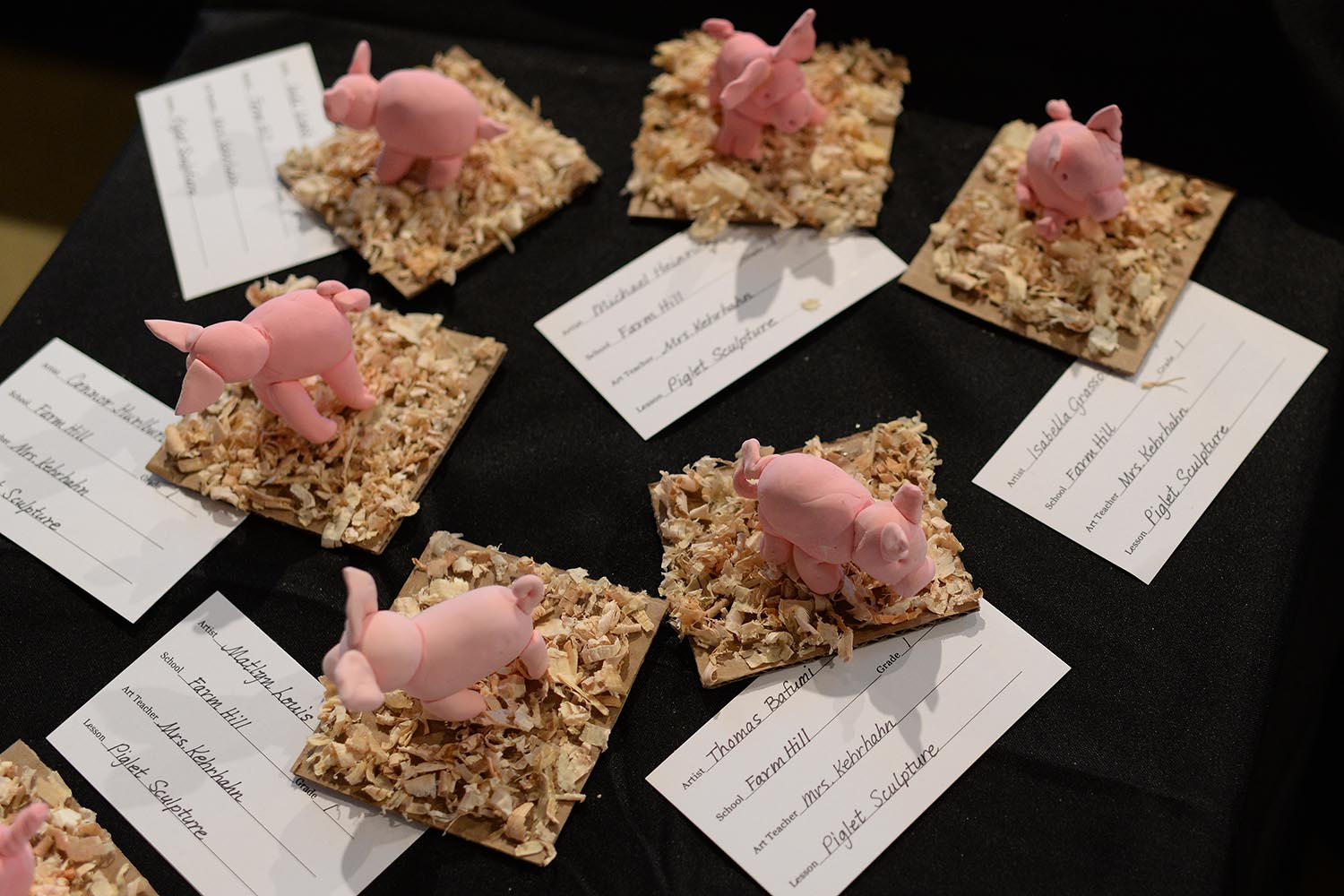 Several first-graders from Farm Hill Elementary School made piglet sculptures.