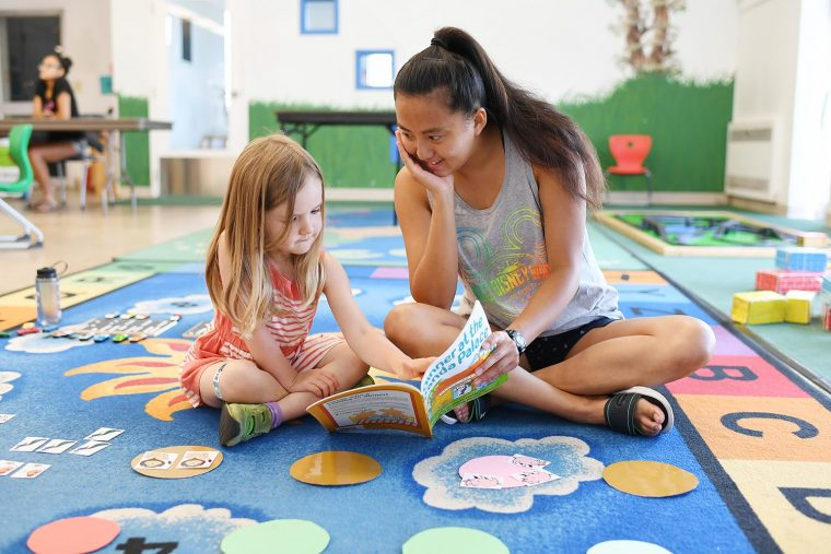Students at Wesleyan have long been interested in studying educational practice and policy, and have been committed to working with local schools and children through a wide variety of programs. Here, Emma Distler '19 plays an interactive reading and counting game with a four-year-old through Kindergarten Kickstart, a research-based, high-impact, low-cost innovative and nurturing preschool program organized by Anna Shusterman and her students every summer.