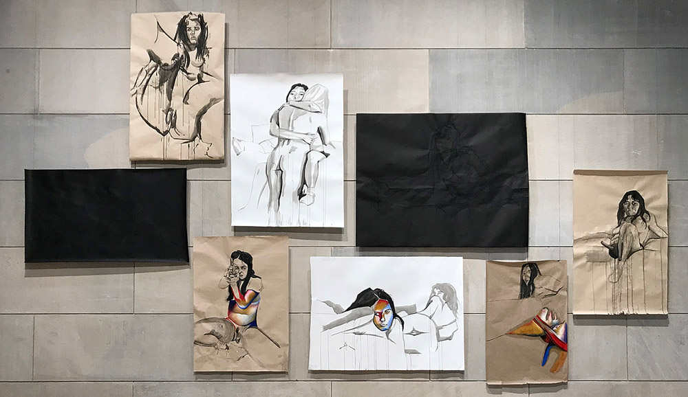 "An Pham's thesis, titled ""This Daughter Mine,"" uses ink and charcoal on paper, interspersed with color from oil pastels. Pham's visual work is accompanied by a written component. ""I explore a lot of inherited trauma and how my mother's body image issues are passed down to me,"" Pham said. ""And this is a celebration in spite of that, a celebration of the flesh of the voluptuousness of my body, of the woman's body in general, and I wanted to use the colorful palette to express that."" Pham elaborated on the relationship between the visual and written aspects of the project. ""I didn't want my drawings to be illustrations of my writing and vice versa,"" Pham explained. ""I didn't want my writing to be captions for my drawings, and so both of these bodies of work have their own journey and exploration of my starting off point, but I believe that they could be very much interpreted and understood on their own and do not need each other. But they would be very much supplemented [by] each other."""
