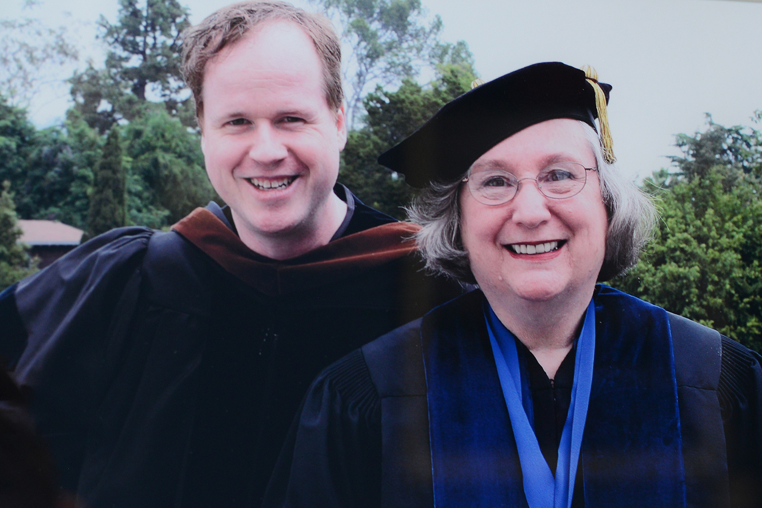 """Joss Whedon '87 presented Jeanine Basinger, the Corwin-Fuller Professor of Film Studies, with an honorary degree from the American Film Institute Conservatory in 2006. This photograph is on display in the """"Buffy to Bard"""" exhibit."""
