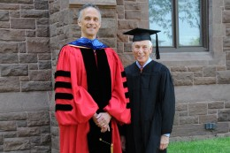 Michael Price received an Honorary Doctorate of Humane Letters this year on May 24. (Photo by John Van Vlack)