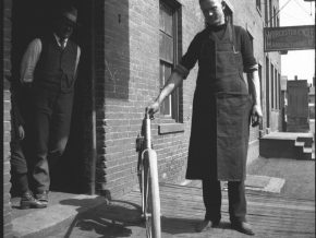 In this historic photo, Hedstrom holds his first motor bike prototype outside Worcester Cycle Manufacturing Company in Middletown. The building was demolished in the 1920s and was located on an extended section of Hamlin Street, which nolonger exists.