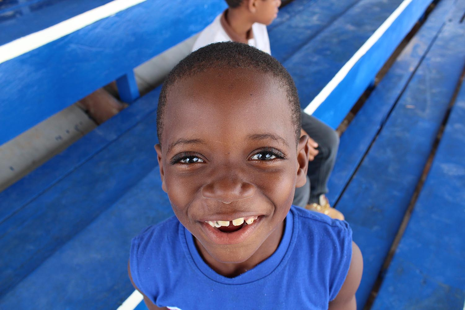 """Shariis Jeffrey '19 won Best Photo of People for her image titled """"Skin Teeth."""" The photo was taken in Linden, Guyana. """"His eyes were smiling at me,"""" Jeffrey said. """"How could I not capture this moment?"""""""